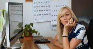 Blonde,Mature,Woman,By,Computer.,Working,From,Home,Office.,Work